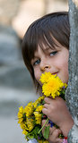 happy girl with yellow flowers