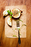 Grilled onion served with fresh basil
