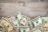 Dollars on wooden background, vintage tone.