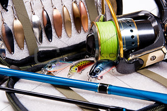 Fishing rod and lures with bag for baits.