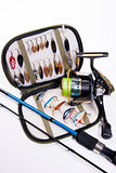 Fishing rod and lures with bag for baits on white.