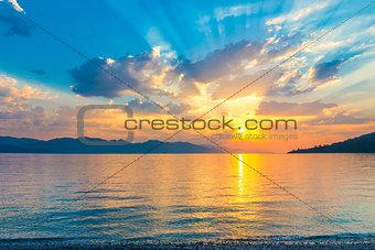 beautiful scenic sunrise over the a quiet Aegean Sea