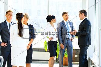 Business seminar where a boss explaining the company