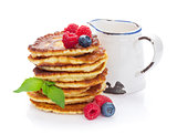 Pancakes with raspberry, blueberry and milk