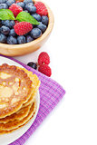 Pancakes with raspberry, blueberry, mint and honey syrup