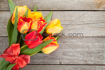 Fresh colorful tulips bouquet with ribbon and bow