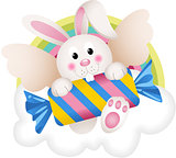 Bunny angel with candy on the cloud