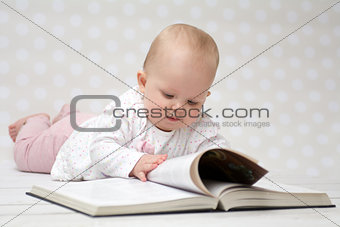 Baby with the book