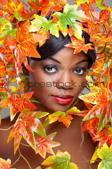 Beautiful young woman wrapped in leafs