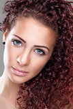Beautiful woman with red curly hair