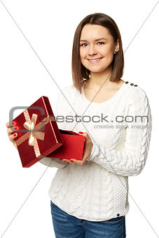 Beautiful woman very happy with the surprise inside of the red box