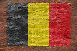 Flag of Belgium on aged brick wall