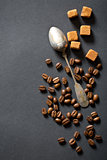 coffee beans, sugar and silver spoon