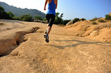 woman running on dirt trail