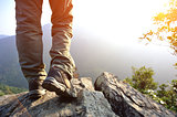 woman hiker legs at mountain peak