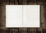 Note book on a dark wood background