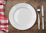 dinner table with dinning plate, fork and knife top view