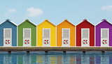 Beach cabins on wooden pier