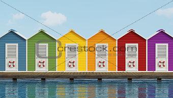 Beach cabins on wooden pier