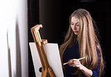 Woman and easel.