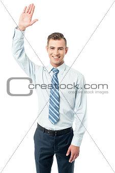Business execuitve raising his hand