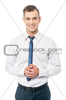 Corporate man posing with clasped hands