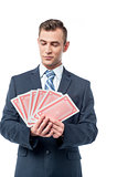 Businessman holding play cards
