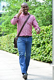 Casual man talking on the phone while walking
