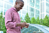 Smiling man using his cell phone