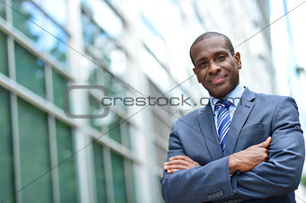African business man keeping arms crossed