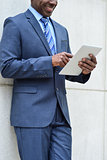 Businessman using a tablet pc, outdoors