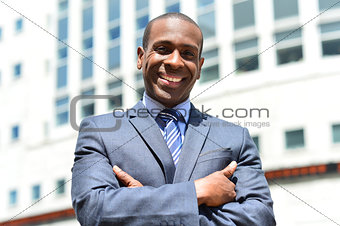 Smiling african businessman at outdoors