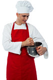 Male chef with whisk and mixing bowl