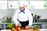 Chef carefully chopping vegetables