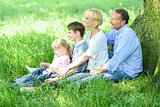 Happy family relaxing in park