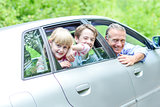 Father enjoying car drive with his kids