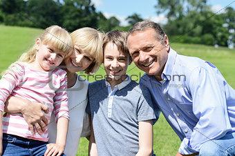 Beautiful happy family enjoying at the park