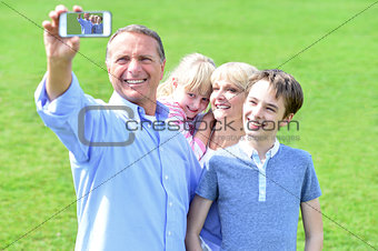 Couple and children taking family picture