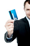 Smiling businessman holding credit card