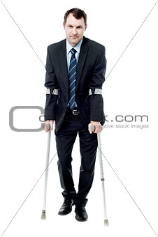 Smart man with crutches trying to walk