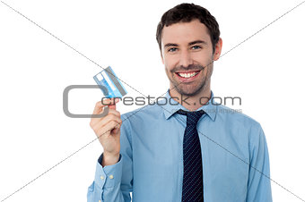 Corporate guy showing his debit card