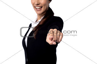 Business woman pointing finger at you