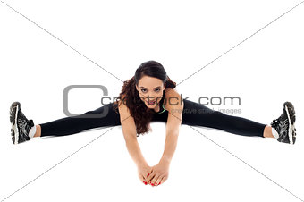 Flexible woman stretching her legs