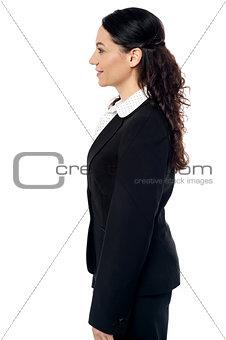 Business woman posing sideways