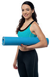 Fitness woman with a gym mat