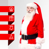 Santa standing with x-mas tags