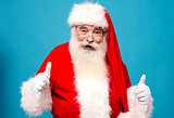 Happy santa claus gesturing thumbsup