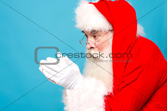Santaclaus about to blow snow