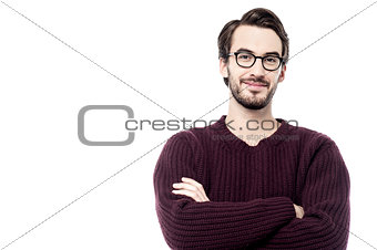 Casual man standing with his arms crossed