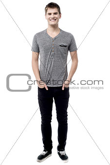 Casual man posing with hands in pockets